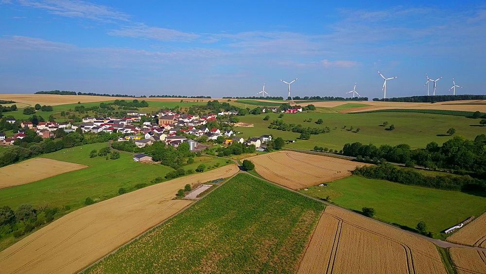 Aerial view of farmland and wind turbines near the town of Kirf, Saargau, Rhineland-Palatinate, Germany
