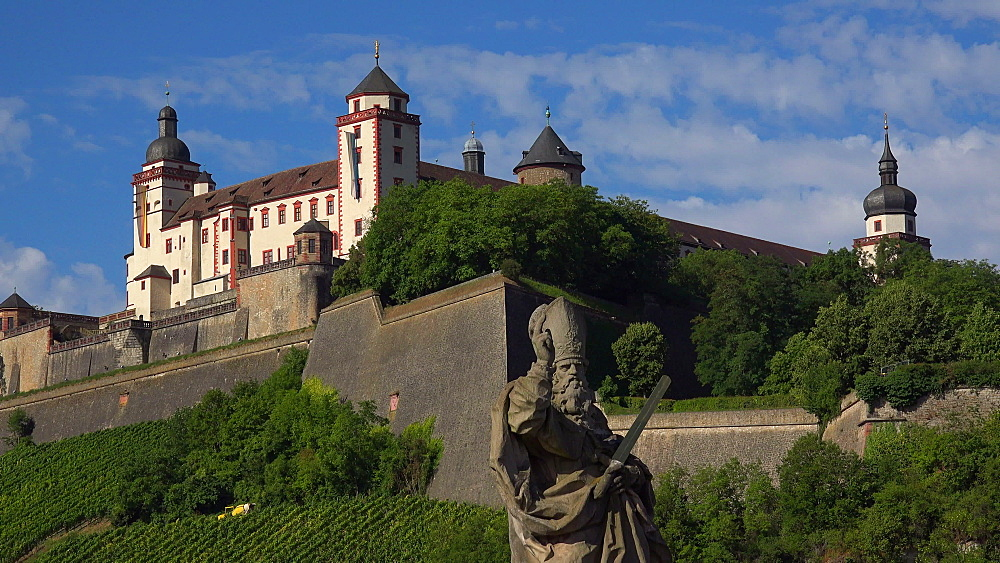 Statue of Saint Kilian on the Old Bridge across River Main with Marienberg Fortress, Wuerzburg, Lower Franconia, Bavaria, Germany