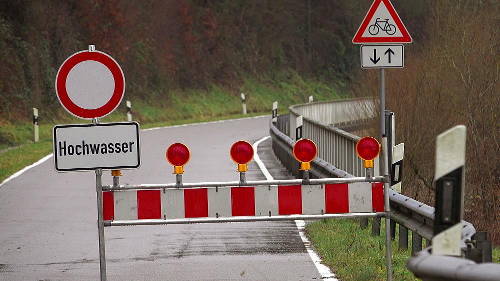 Roadblock of a country road at flood, Saar river, Saar Valley near Staadt, Rhineland-Palatinate, Germany
