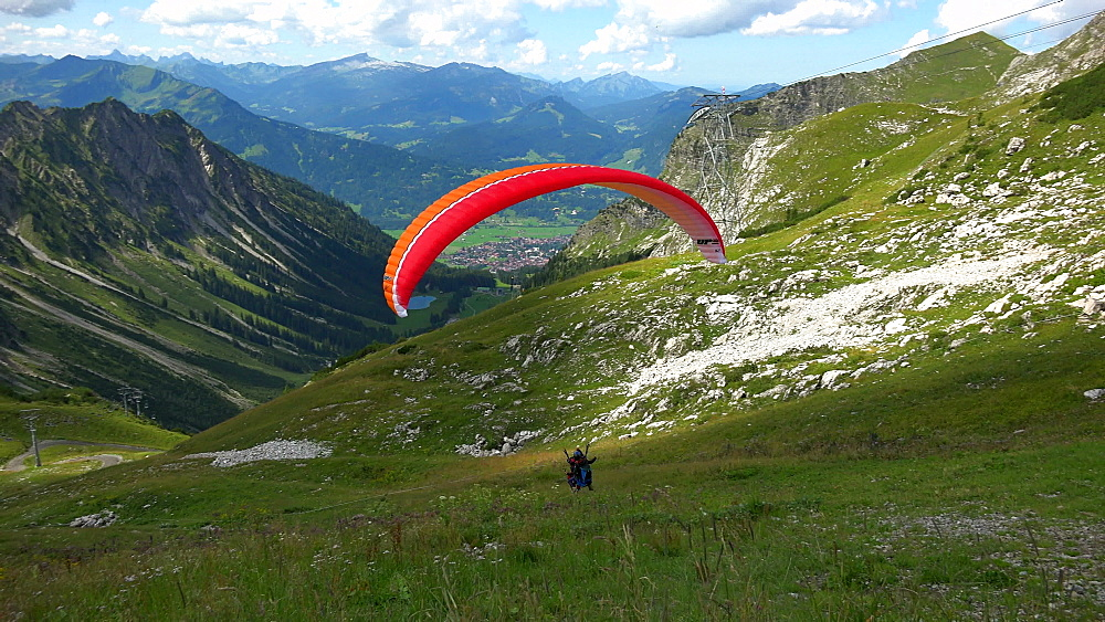Paraglider starting at Hoefatsblick station, Nebelhorn Mountain (2224m), Oberstdorf, Allg?u, Swabia, Bavaria, Germany - 396-9291