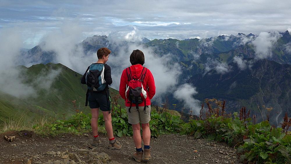 Hiker at the peak of Fellhorn Mountain Mountain near Oberstdorf, Allg?u, Swabia, Bavaria, Germany - 396-9307