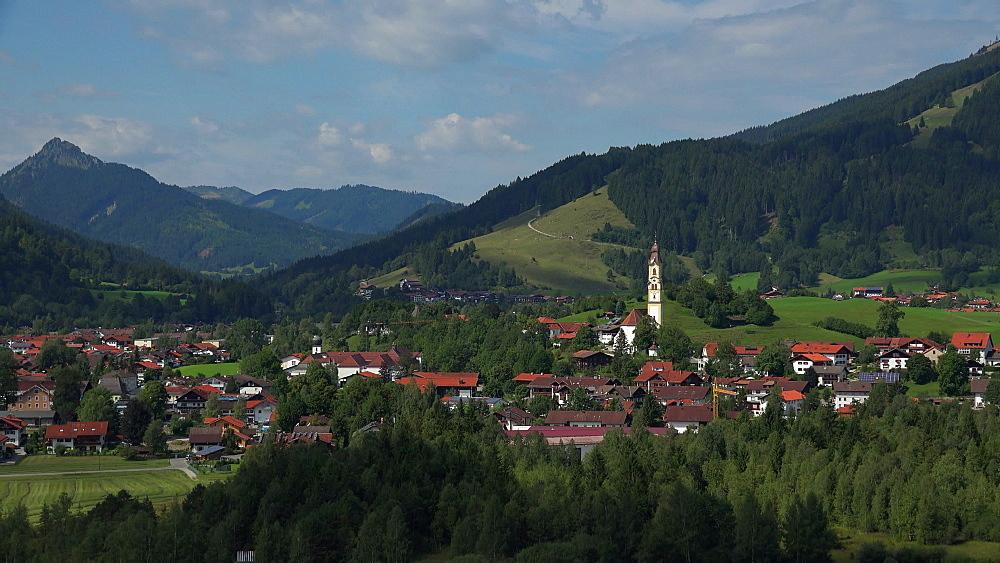 View towards the Town of Pfronten, Allgaeu, Swabia, Bavaria, Germany