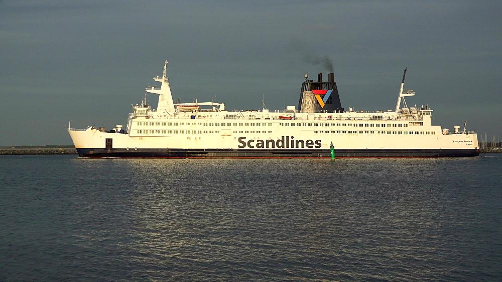 Scandlines ferry ship leaving the harbour of Warnemuende, Rostock, Mecklenburg-Western Pomerania, Germany