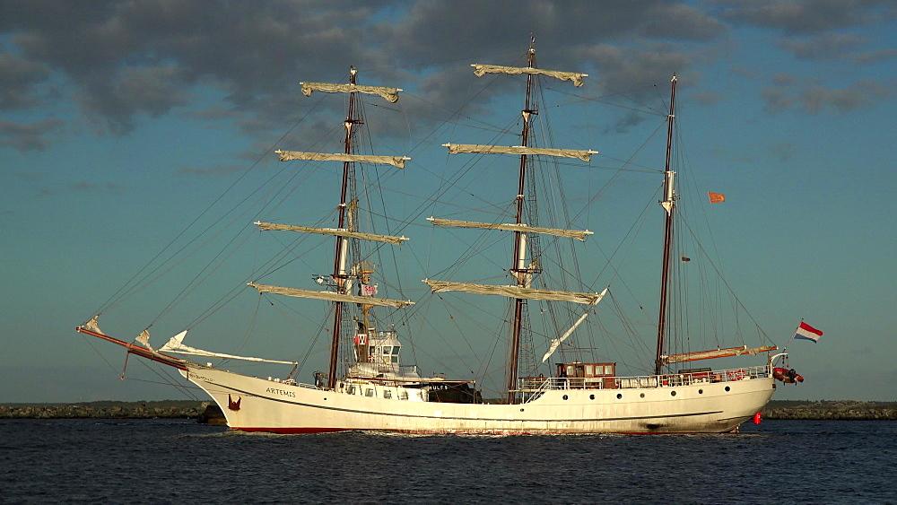 Sailing ship leaving the harbour of Warnemuende, Rostock, Mecklenburg-Western Pomerania, Germany