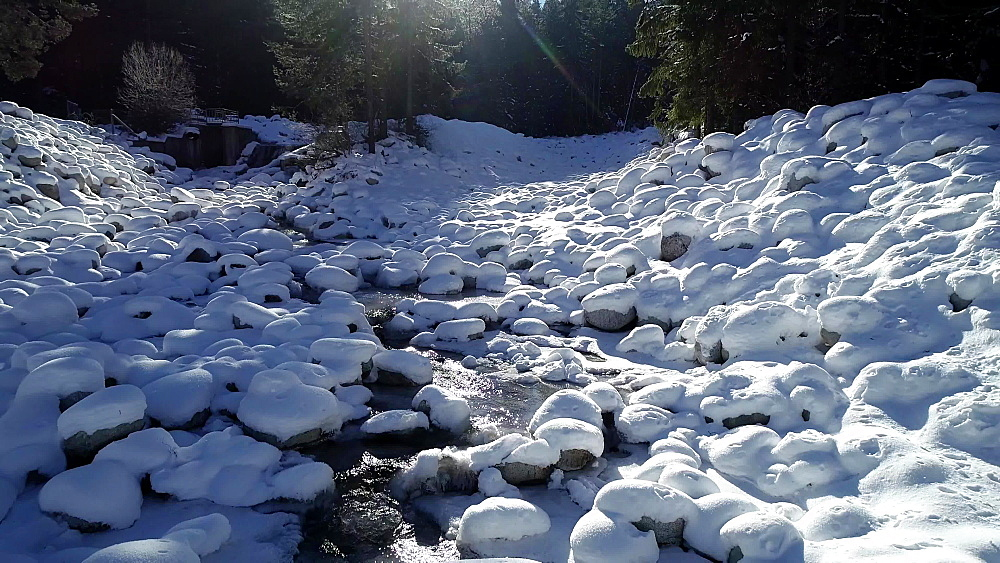 Snow covered river near Bansko town in Pirin National Park UNESCO World Heritage Site, Bulgaria, Europe