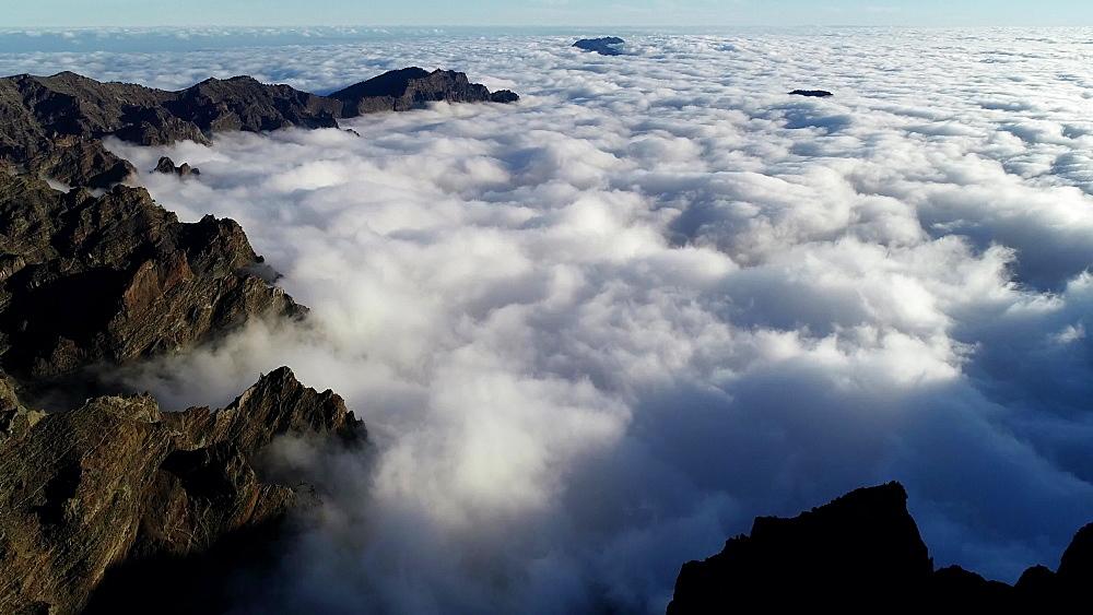 View looking into the cloud filled volcanic caldera of National Park Caldera de Taburiente, UNESCO Biosphere Site, La Palma, Canary Islands, Spain, Atlantic, Europe