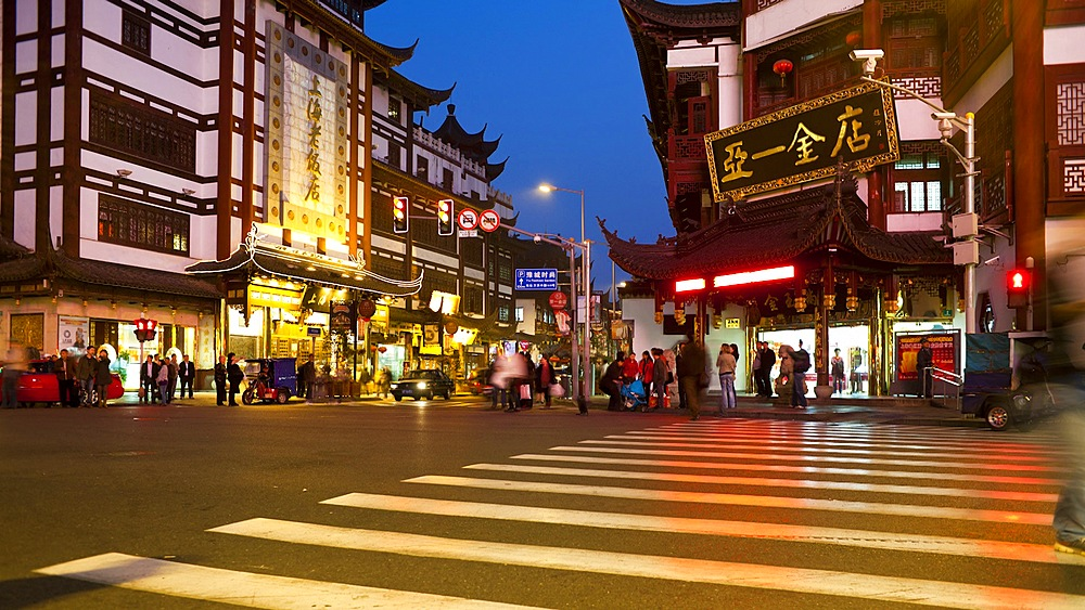 People crossing into Yuyuan Bazaar district at night, Shanghai, China, Asia, T/Lapse