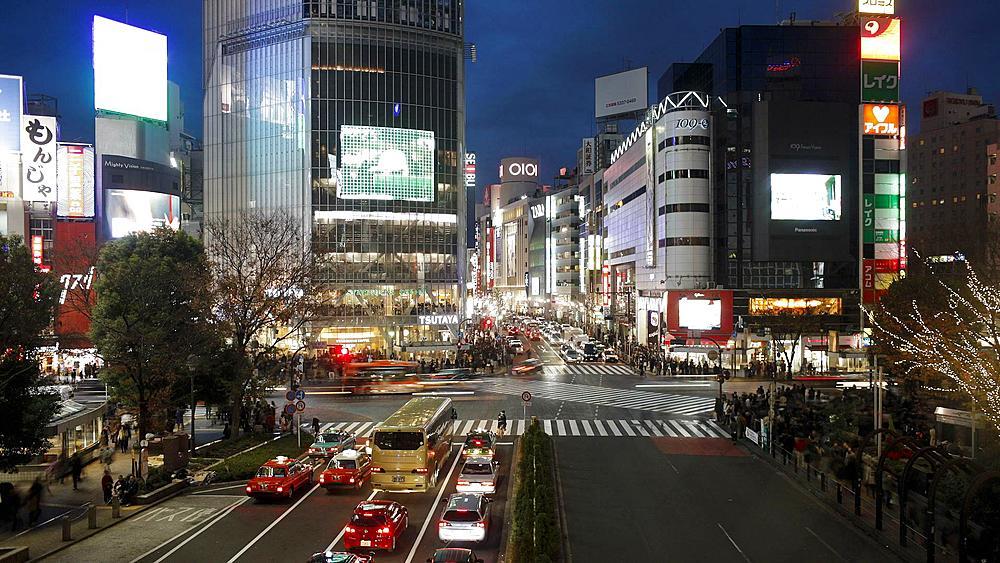 Wide shot of Pedestrians and traffic across Shibuya Crossing, Shibuya, Tokyo, Honshu, Japan, Asia, T/Lapse