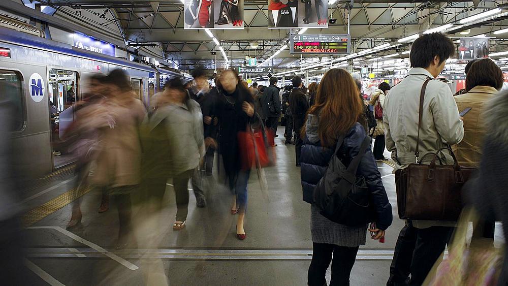 Commuters walking through Shibuya Station at rush hour, Shibuya, Tokyo, Honshu, Japan, Asia, T/Lapse