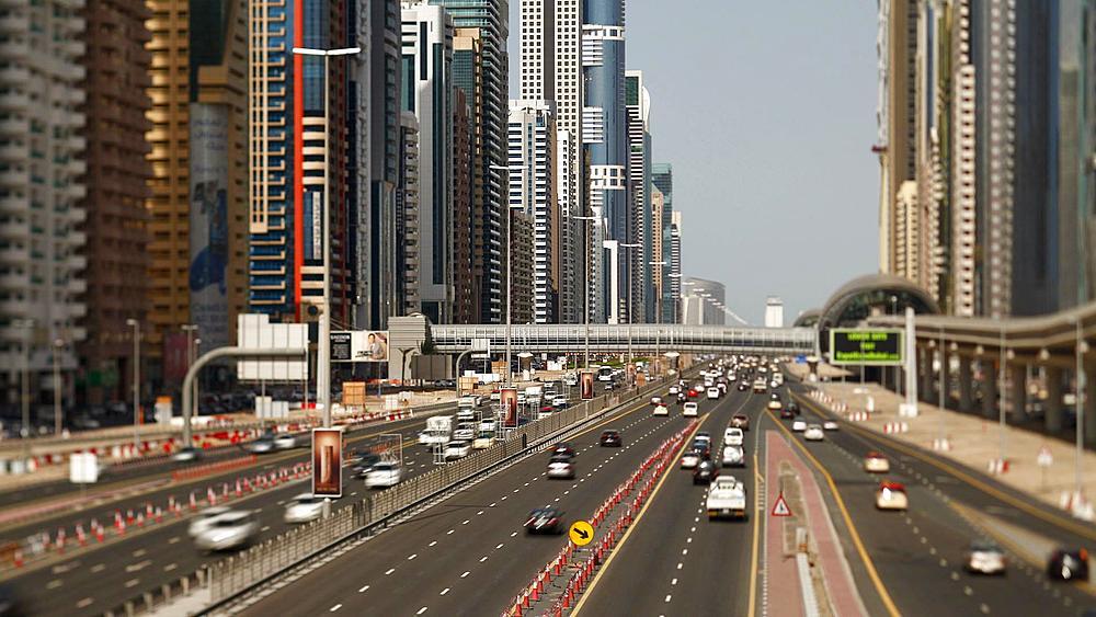 United Arab Emirates, Dubai, Sheikh Zayed Rd, traffic and new high rise buildings along Dubai's main road, T/Lapse