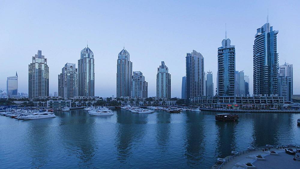 Dusk to night Time Lapse transition of Dubai Marina, a modern Development set amidst the futuristic Skyline of a modern Middle East Country, Dubai, Arabian Peninsula, UAE
