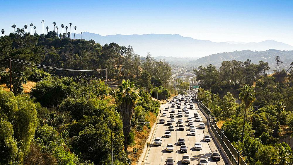 Elevated view of busy traffic on the Pasadena Freeway, Los Angeles, California, United States of America, T/lapse