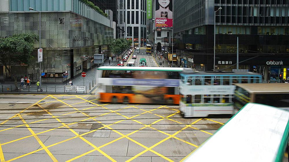 Traffic crossing on Des Voeux Road in Central, Hong Kong Island, Hong Kong, China, T/lapse