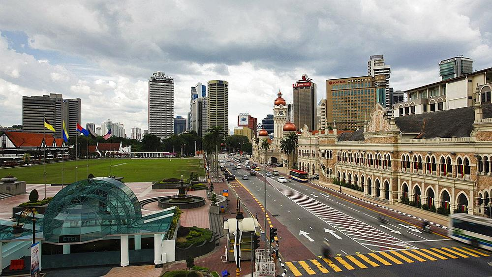 Elevated view of traffic in Merdaka Square including the Sultan Abdul Samad Building, Kuala Lumpur, Malaysia, Asia, Time lapse