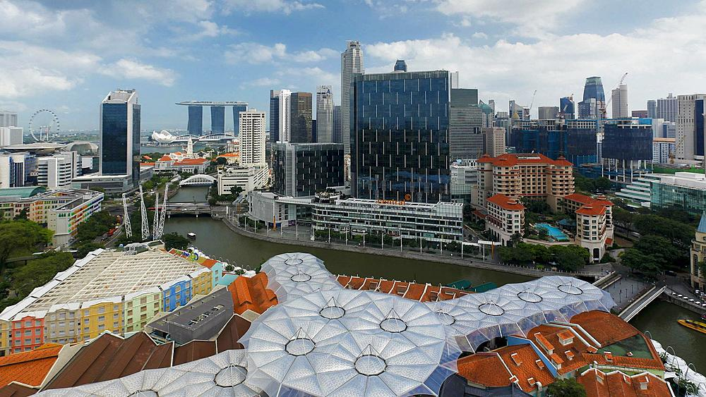 Elevated view over the Entertainment district of Clarke Quay, the Singapore river and City Skyline, South East Asia, Time lapse