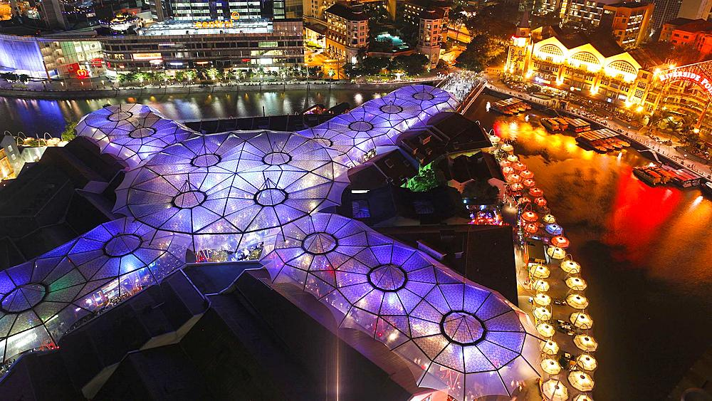 Elevated view over the Entertainment district of Clarke Quay and Singapore river, South East Asia, Time lapse