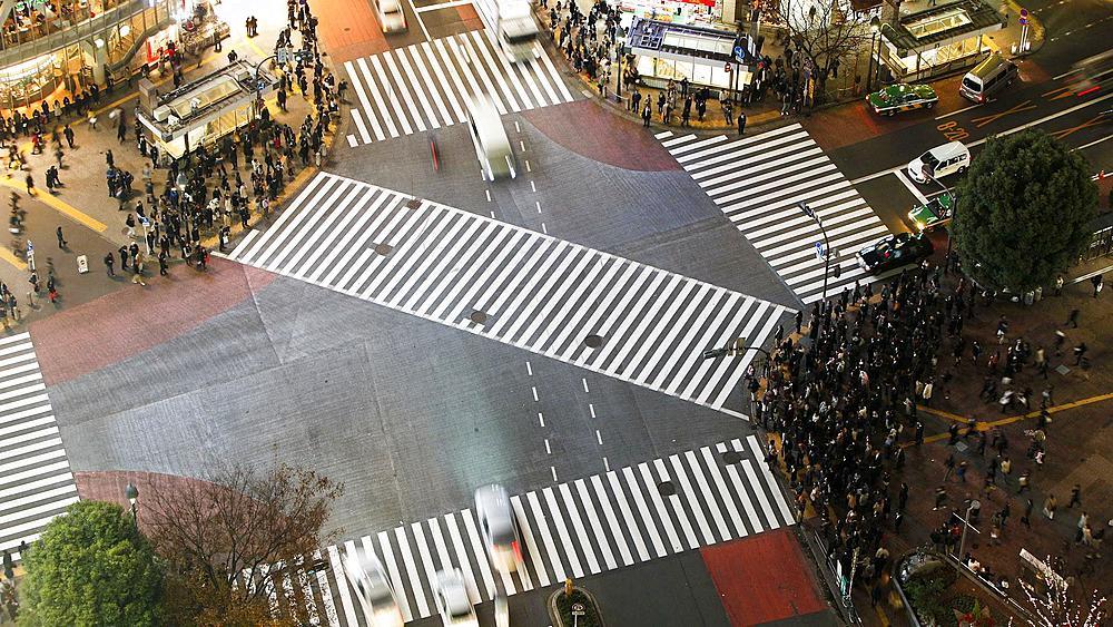 T/L High angle shot pedestrians and traffic across Shibuya Crossing, Hachiko Crossing, Shibuya, Tokyo, Honshu, Japan
