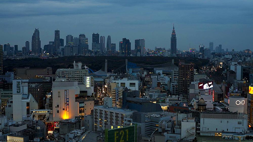 T/L Moving clouds over Shinjuku business, shopping and entertainment district, viewed from Shibuya, Honshu, Tokyo, Japan