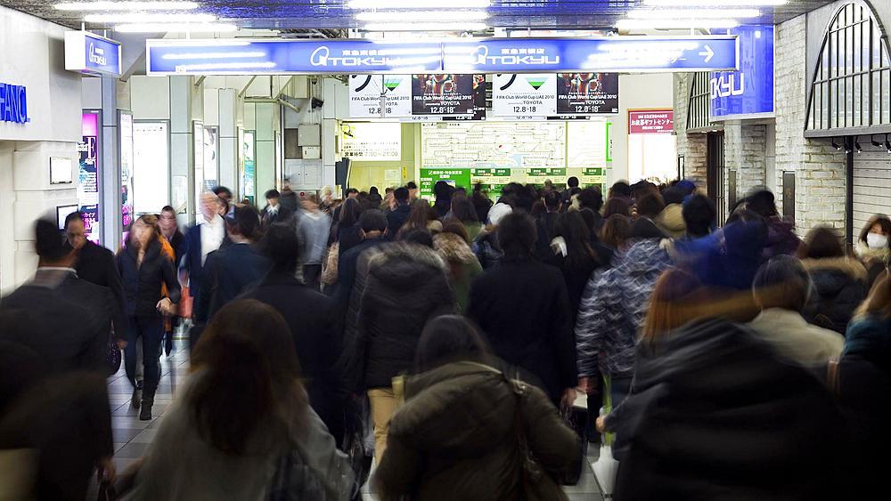T/L Commuters walking through Shibuya Station at rush hour, Shibuya, Tokyo, Honshu, Japan