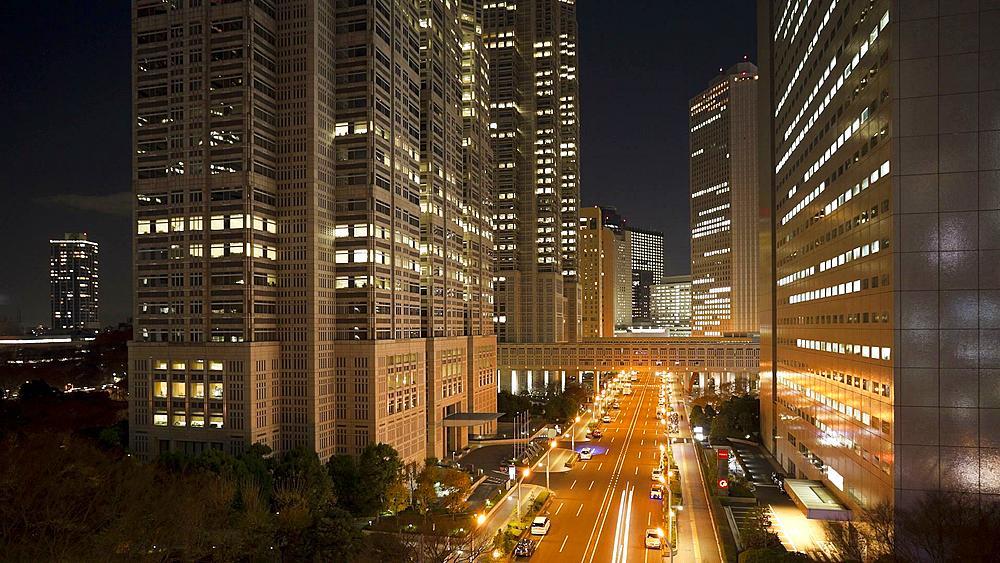 T/L Clouds passing office buildings at night, Shinjuku, Tokyo, Honshu, Japan