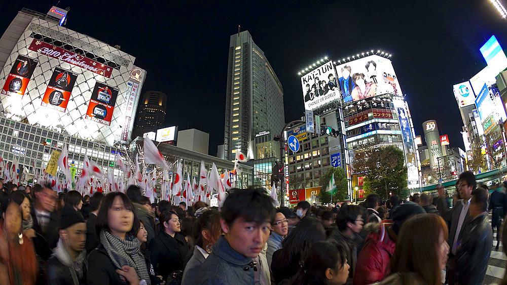T/L  Pedestrians and traffic across Shibuya Crossing at night, Shibuya, Tokyo, Honshu, Japan
