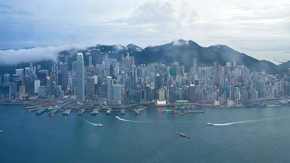 Aerial view over Hong Kong Island looking towards Victoria Peak showing the busy Victoria Harbour and Financial District of Central, Hong Kong, China, T/lapse - 794-2763