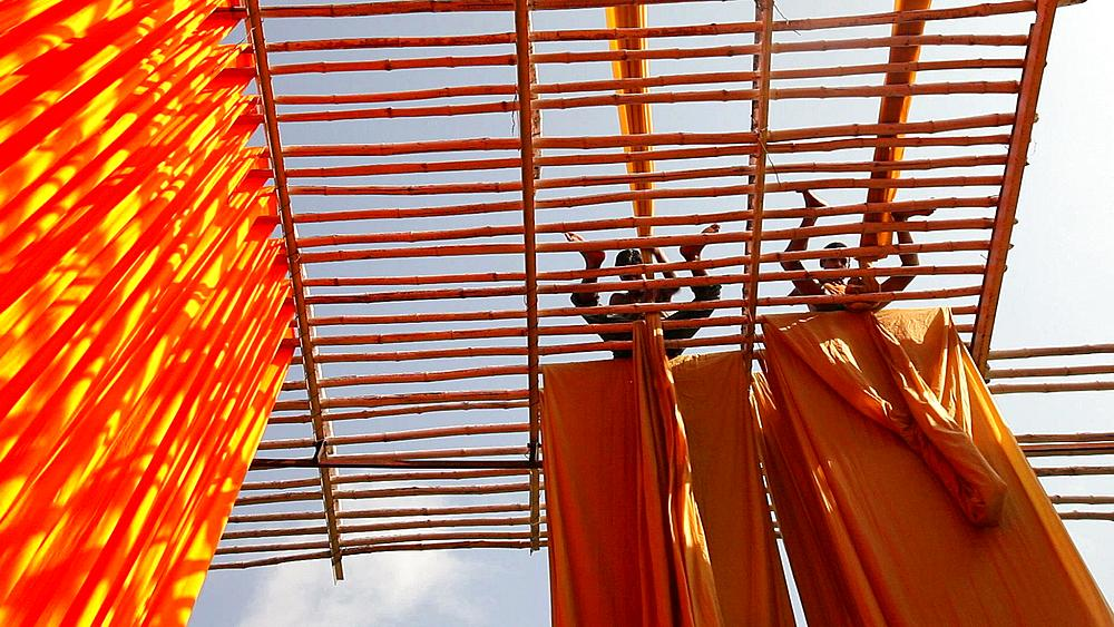 Newly dyed fabric being hung up to dry, Sari garment factory, Rajasthan, India, Asia, MR,PR