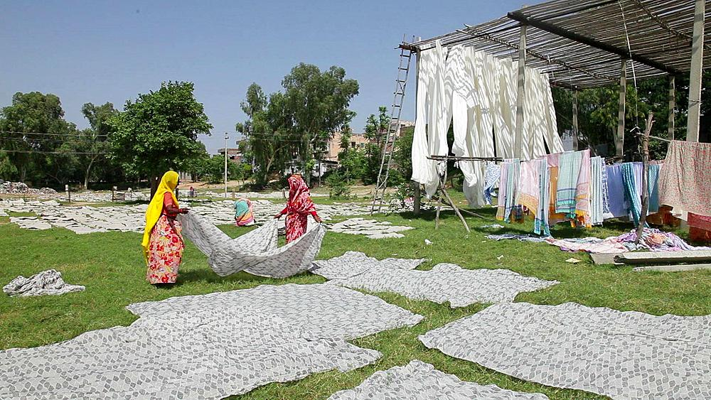 Newly dyed fabric being hung up to dry, Sari garment factory, Rajasthan, India, Asia, MR