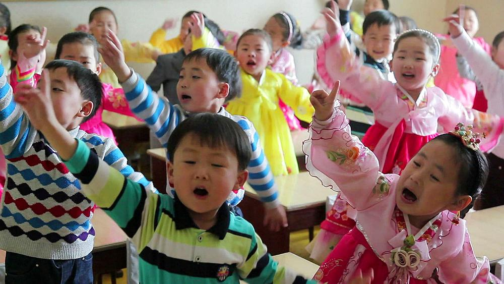 Pyongyang, schoolchildren singing in a classroom, North Korea, Asia - 794-3104