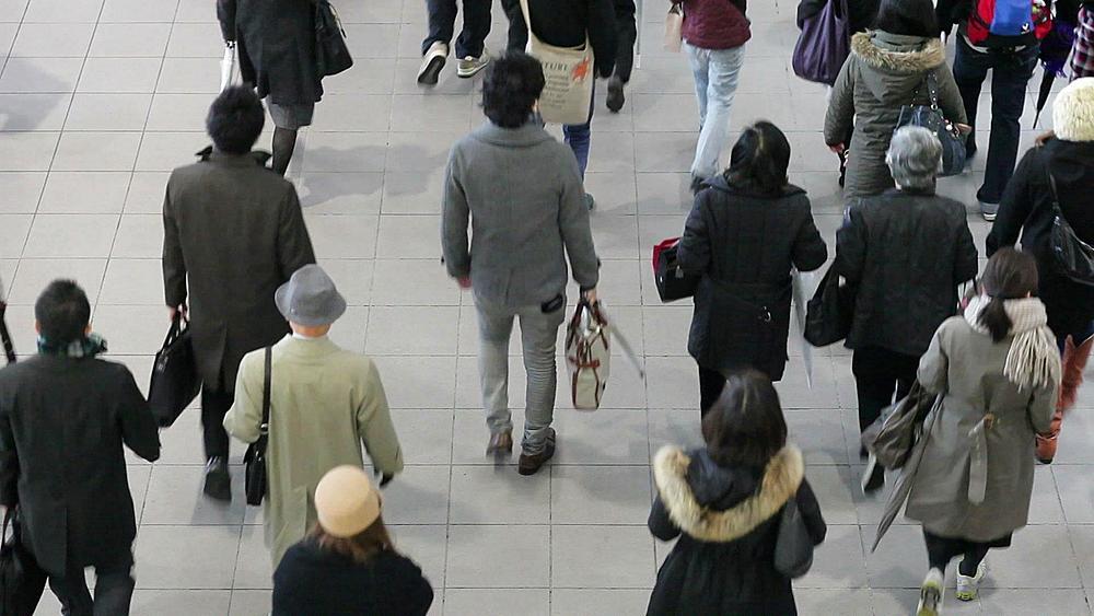 Shibuya District, commuters moving through Shibuya Station during rush hour, Tokyo, Japan, Asia