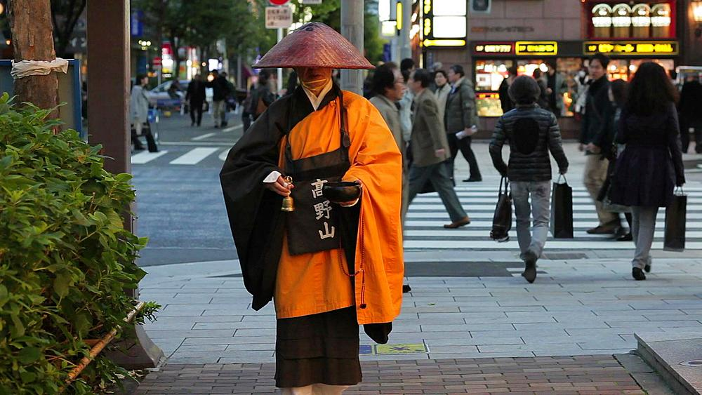 Asia, Japan, Honshu, Tokyo, Ginza, Shinto monk in traditional dress on the most fashionable street in Tokyo collecting Alms, donations, Japan, Honshu, Tokyo, Asia