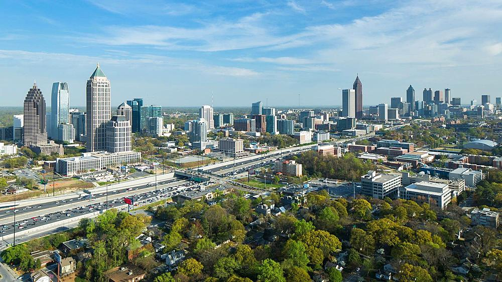 Elevated view over Interstate 85 passing the Midtown and Downtown Atlanta skyline, Georgia, United States of America - 794-4183