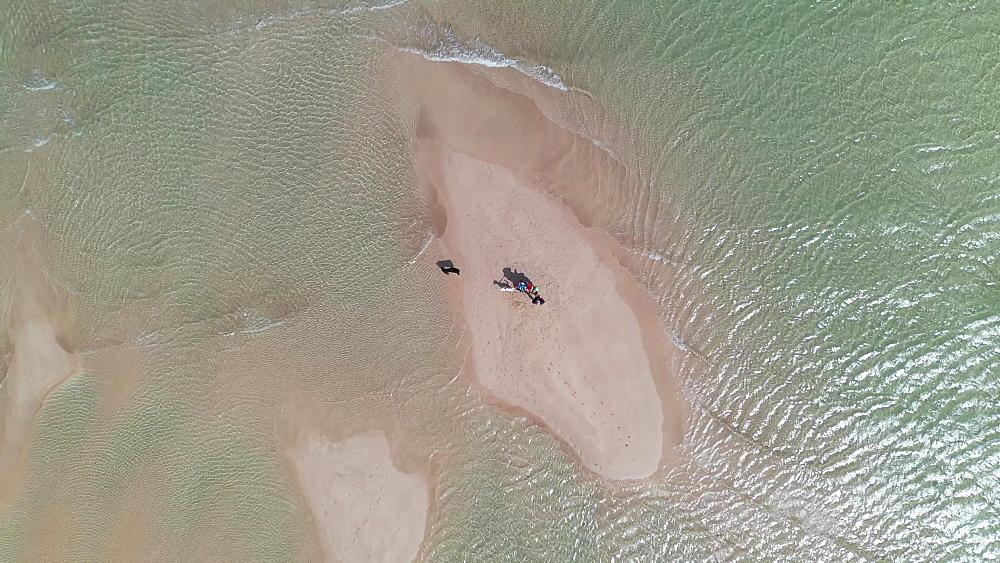 Aerial of family on a beach, Cornwall, England, United Kingdom, Europe