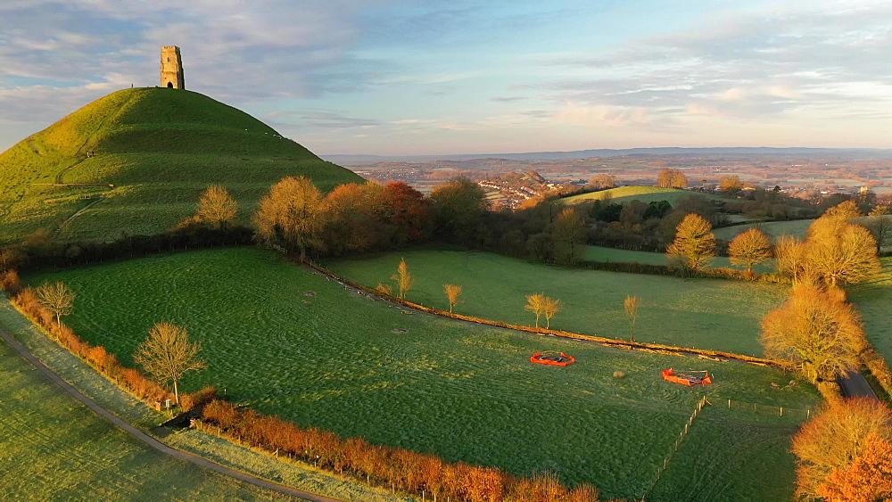 Aerial of Glastonbury Tor in morning light, Glastonbury, Somerset, England, United Kingdom, Europe - 799-4027