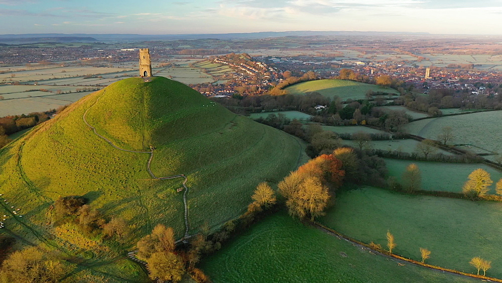 Aerial of Glastonbury Tor in morning light, Glastonbury, Somerset, England, United Kingdom, Europe