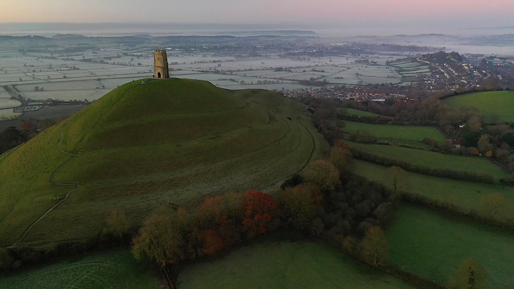 Aerial of Glastonbury Tor at dawn Glastonbury, Somerset, England, United Kingdom, Europe