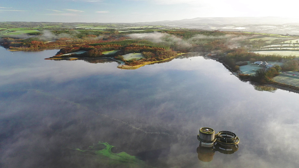 Aerial of Roadford Lake with morning mist, Devon, England, United Kingdom, Europe