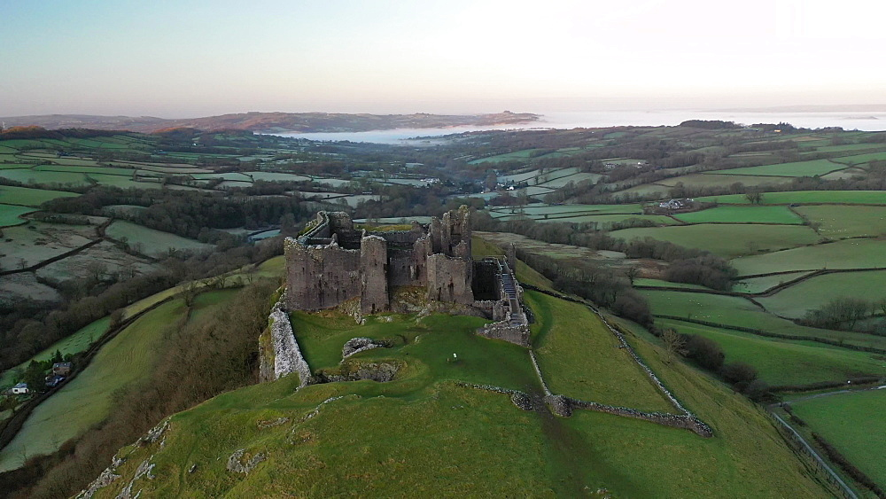 Aerial of Carreg Cennen Castle at dawn, Trapp, Brecon Beacons, Carmarthenshire, Wales, United Kingdom, Europe