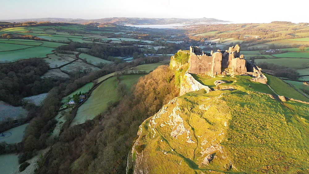 Aerial clip of Carreg Cennen Castle at dawn, Trapp, Brecon Beacons, Wales
