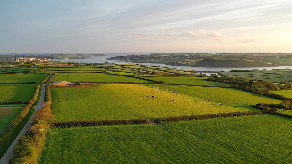 Aerial clip of rolling farmland near the Camel Estuary, Cornwall, England