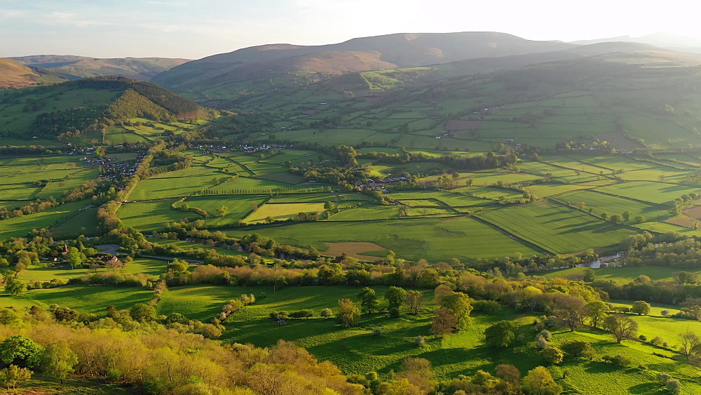 Aerial clip of countryside and mountain scenery in the Brecon Beacons National Park, Powys, Wales