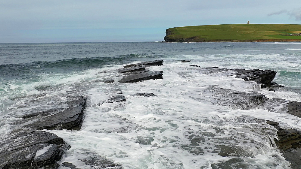 Waves crashing over rocks near Marwick Head on Mainland, Orkney, Scotland