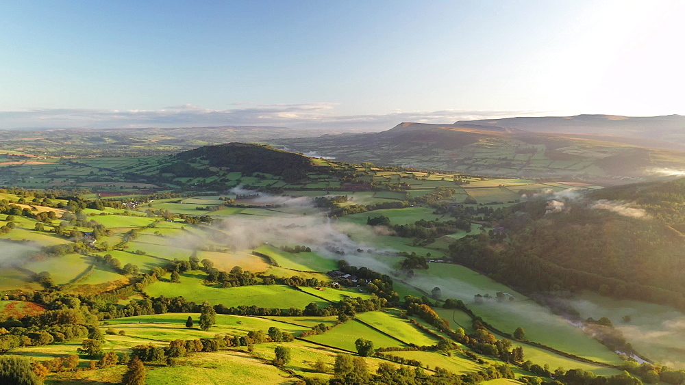 Aerial clip of rolling countryside of the Usk Valley, Brecon Beacons National Park, Powys, Wales