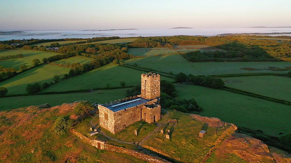 Aerial clip of Brentor Church in Dartmoor National Park, Devon, England