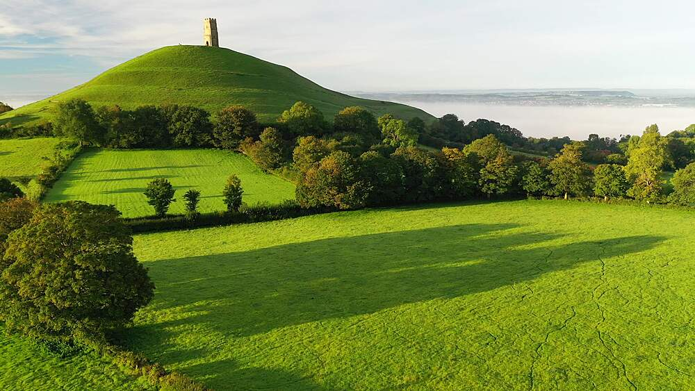 Aerial of Glastonbury Tor and surrounding countryside at dawn in late summer, Somerset, England, United Kingdom, Europe - 799-4118