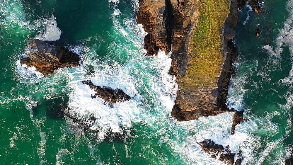 Aerial of dramatic North Cornish coastline near Treyarnon Beach, Cornwall, England, United Kingdom, Europe