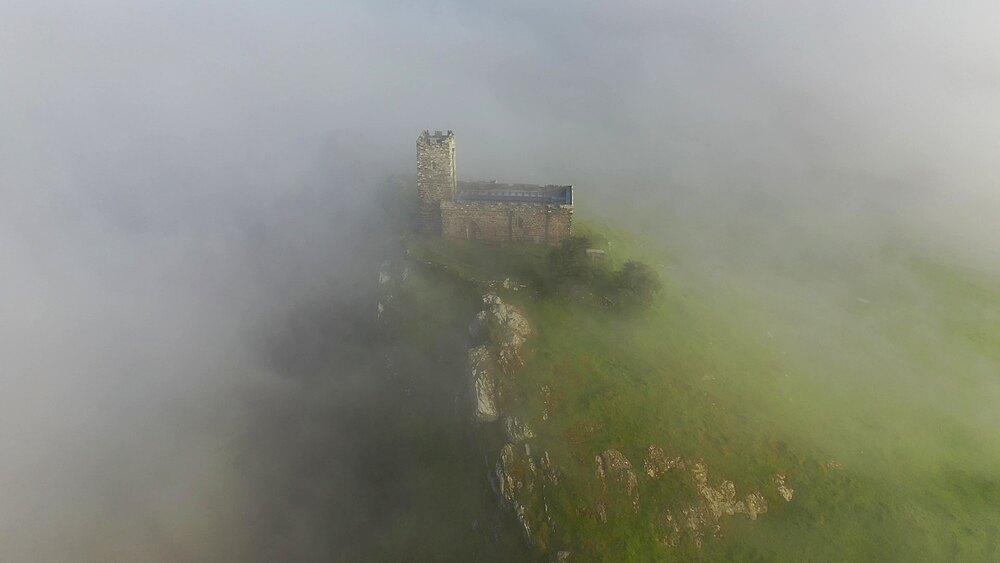 Aerial of Brentor Church surrounded by morning mist, Dartmoor, Devon, England, United Kingdom, Europe - 799-4133
