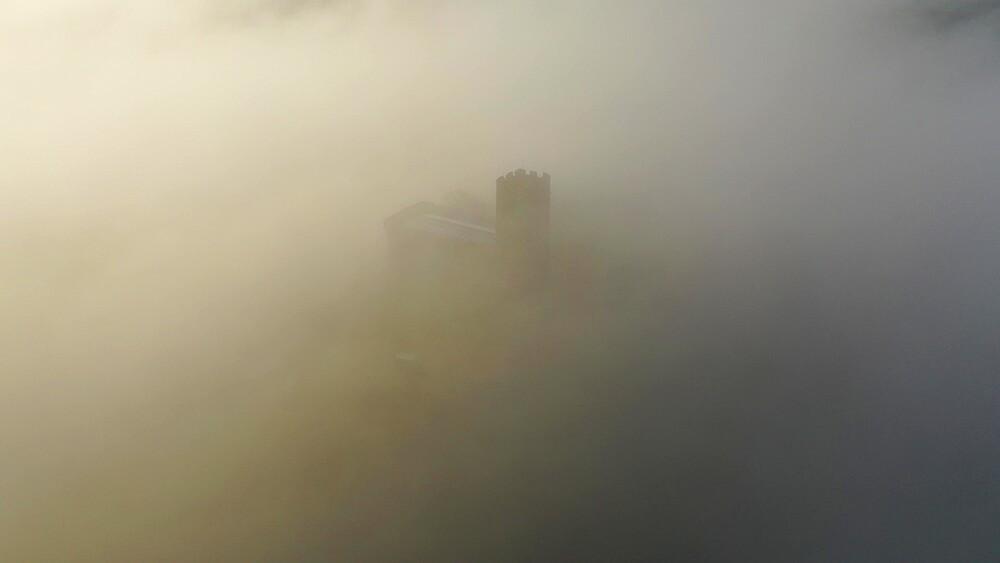Aerial of Brentor Church surrounded by morning mist, Dartmoor, Devon, England, United Kingdom, Europe - 799-4135