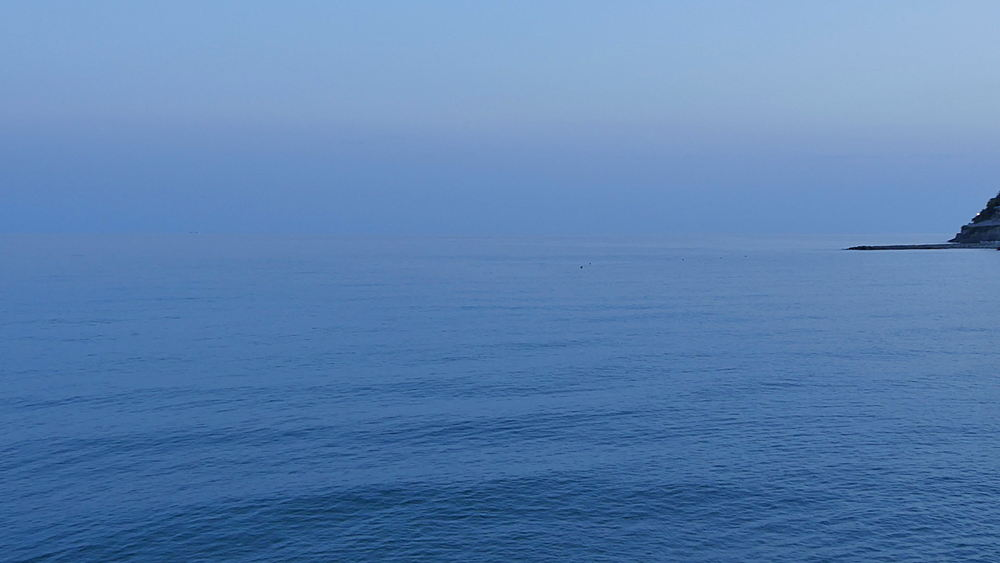 Beach scene and town as backdrop, Porto Maurizio, Imperia, Province of Imperia, Liguria, Italy, Europe  - 844-10302
