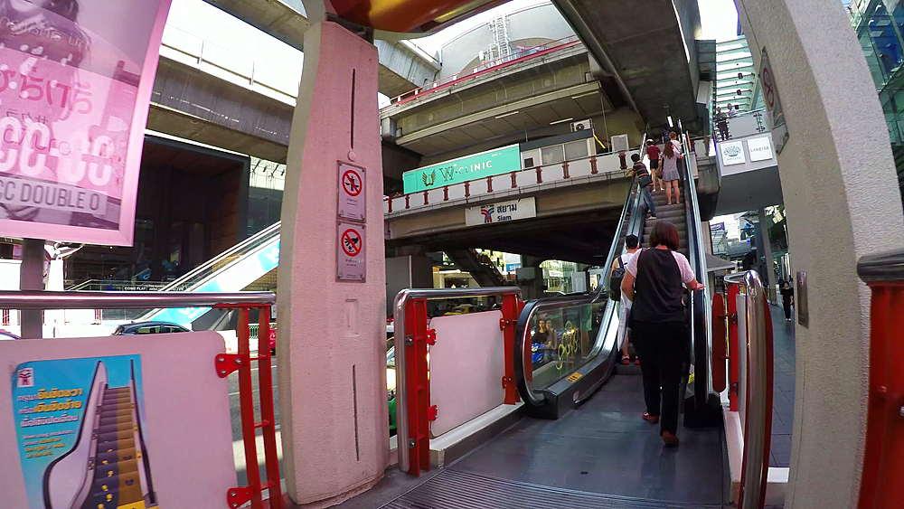 Escalator to Skytrain on Ratchadamri Road, Bangkok, Thailand, South Asia, Asia